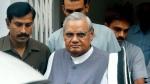In this Aug. 23, 2004 file photo, senior Bharatiya Janta Party (BJP) leader Atal Bihari Vajpayee, centre, leaves after a meeting at the party headquarters in New Delhi, India. (AP Photo/Sebastian John, File)