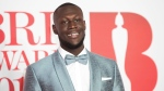 In this Wednesday, Feb. 21, 2018 file photo, Stormzy poses for photographers upon his arrival at the Brit Awards 2018 in London. (Photo by Vianney Le Caer/Invision/AP, File)