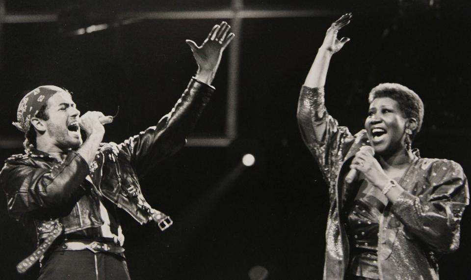 Aretha Franklin joins George Michael during his Faith World Tour in Auburn Hills, Mich., Aug. 30, 1988. (AP Photo/Rob Kozloff)