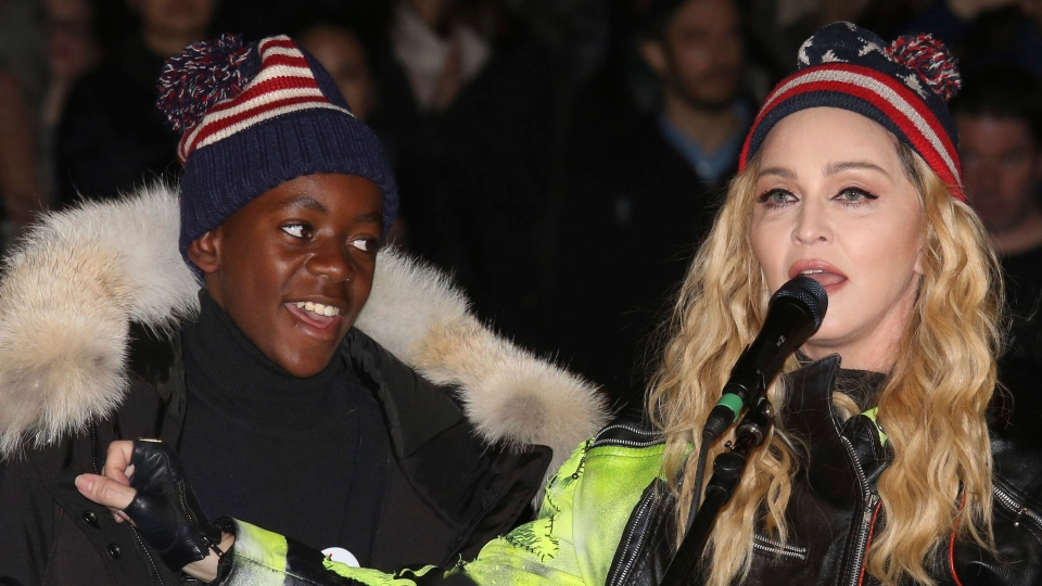 In this Nov 7, 2016 file photo, U.S. Singer Madonna, right, and her son David Banda perform in support of Democratic presidential candidate Hillary Clinton at Washington Square Park. (Photo by Greg Allen/Invision/AP file)