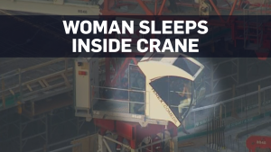 Police arrest woman found sleeping in crane