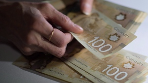 Canadian $100 bills are counted in Toronto in a Feb. 2, 2016, file photo. THE CANADIAN PRESS/Graeme Roy
