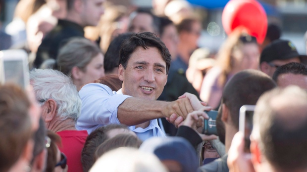 Prime Minister Justin Trudeau shakes hand with people at a picnic in Rouyn-Noranda, Que., Wednesday, August 15, 2018 THE CANADIAN PRESS/Jacques Boissinot