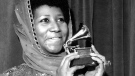"In this March 3, 1975 file photo, singer Aretha Franklin poses with her Grammy Award for for best female R&B vocal performance for ""Ain't Nothing Like the Real Thing"" at the 17th Annual Grammy Award presentation in New York. Franklin died Thursday, Aug. 16, 2018 at her home in Detroit. She was 76. (AP Photo, File)"