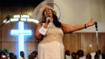 Aretha Franklin sings during a memorial service for her father and brother, Rev. C.L. and Rev. Cecil Franklin, at New Bethel Baptist Church, where they were ministers, in Detroit, Mich., on Sunday, June 7, 2015. (Elizabeth Conley/The Detroit News via AP)
