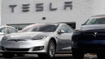 In this July 8, 2018, photo, 2018 Model 3 sedan sits next to a Model X on display outside a Tesla showroom in Littleton, Colo. (AP Photo/David Zalubowski)