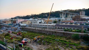 Firefighters remove debris of the collapsed Morandi highway bridge in Genoa, Italy, Thursday, Aug. 16, 2018. (Luca Zennaro/ANSA via AP)