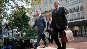 Defense attorneys Kevin Downing, left, Richard Westling, center, and Thomas Zehnle, part of the defense team for Paul Manafort, walk to federal court as jury deliberations begin in the trial of the former Trump campaign chairman, in Alexandria, Va., Thursday, Aug. 16, 2018. (AP Photo/Jacquelyn Martin)