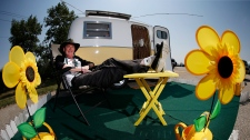 Ian Giles relaxes outside his trailer at the Boler 50th anniversary celebration weekend in Winnipeg on Wednesday, August 15, 2018. THE CANADIAN PRESS/John Woods