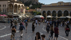 People walk at Monastiraki square in Athens, on Thursday, June 21, 2018. Eurozone nations are working on the final elements of a plan to get Greece successfully out of its eight-year bailout program and keep its massive debt burden manageable.(AP Photo/Petros Giannakouris)