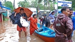 Flood victims are evacuated to safer areas in Kozhikode, in the southern Indian state of Kerala, Thursday, Aug. 16, 2018. (AP Photo/K. Shijith)