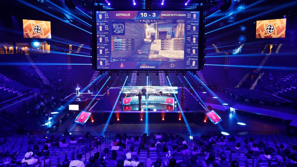 In this Feb. 18, 2017, file photo, teams compete against each other during the Dreamhack Masters e-sports tournament at the MGM Grand Garden Arena in Las Vegas. (AP Photo/John Locher, File)