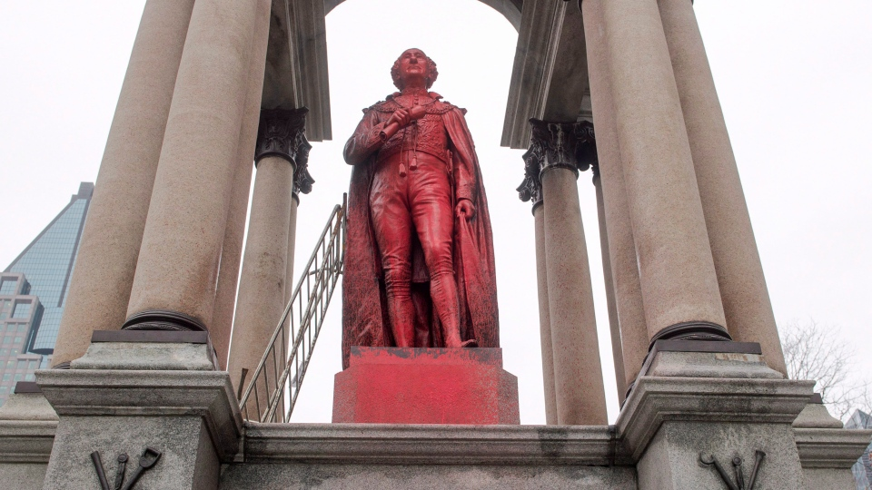 A statue of Sir John A. Macdonald is seen after being vandalized Monday, November 13, 2017 in Montreal. The statue appears covered in what appeared to be red paint with profanity painted at the base of the monument. THE CANADIAN PRESS/Ryan Remiorz