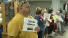 Volunteer drivers wait in the arrivals lounge of the Fredericton airport for incoming law enforcement personnel (Jonathan MacInnis / CTV Atlantic)
