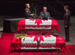 Members of the Fredericton Police Force place medals, hat and ceremonial belt on the casket for Const. Robb Costello at the regimental funeral for Costello and Const. Sara Burns, killed in the line of duty, in Fredericton on Saturday, Aug. 18, 2018. THE CANADIAN PRESS/Andrew Vaughan