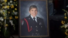 A portrait of Const. Sara Burns is surrounded by floral arrangements at the regimental funeral for Burns and Const. Robb Costello, killed in the line of duty, in Fredericton on Saturday, Aug. 18, 2018. The two city police officers were among four people who died in a shooting in a residential area on the city's north side. THE CANADIAN PRESS/Andrew Vaughan