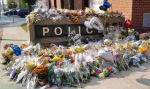 This photo from the Twitter account of the London Police Service shows the outpouring of support for the slain officers in Fredericton.