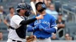 New York Yankees catcher Kyle Higashioka, left, gestures as Toronto Blue Jays' Teoscar Hernandez reacts after striking out looking on a pitch from starting pitcher A.J. Cole to in the ninth inning to end a baseball game, Saturday, Aug. 18, 2018, in New York. (AP Photo / Julio Cortez)
