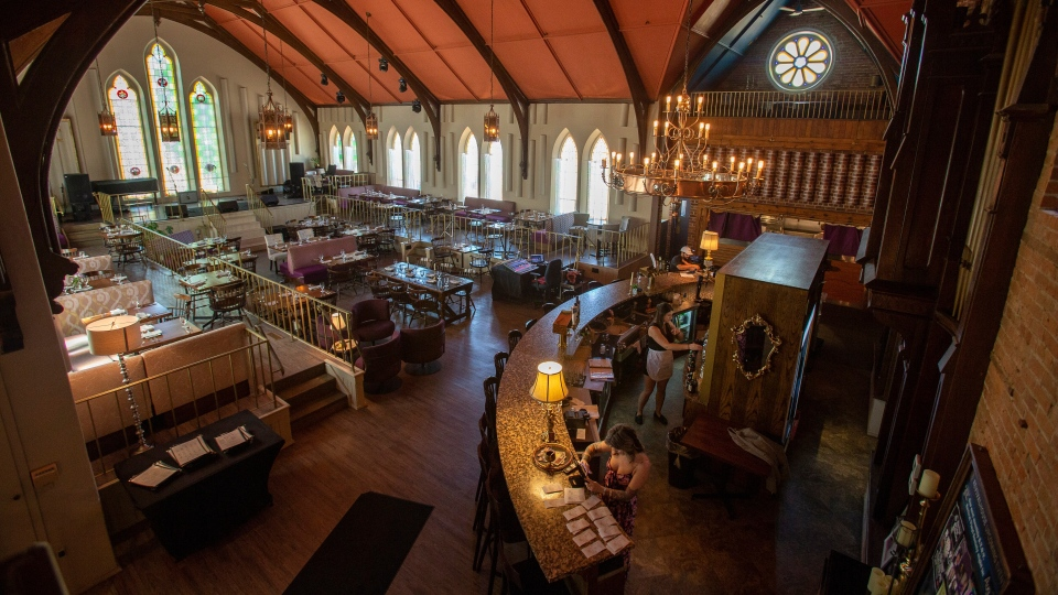 Tables are set for patrons at the Revival House restaurant in Stratford, Ont., on Friday, August 10, 2018. THE CANADIAN PRESS/Geoff Robins