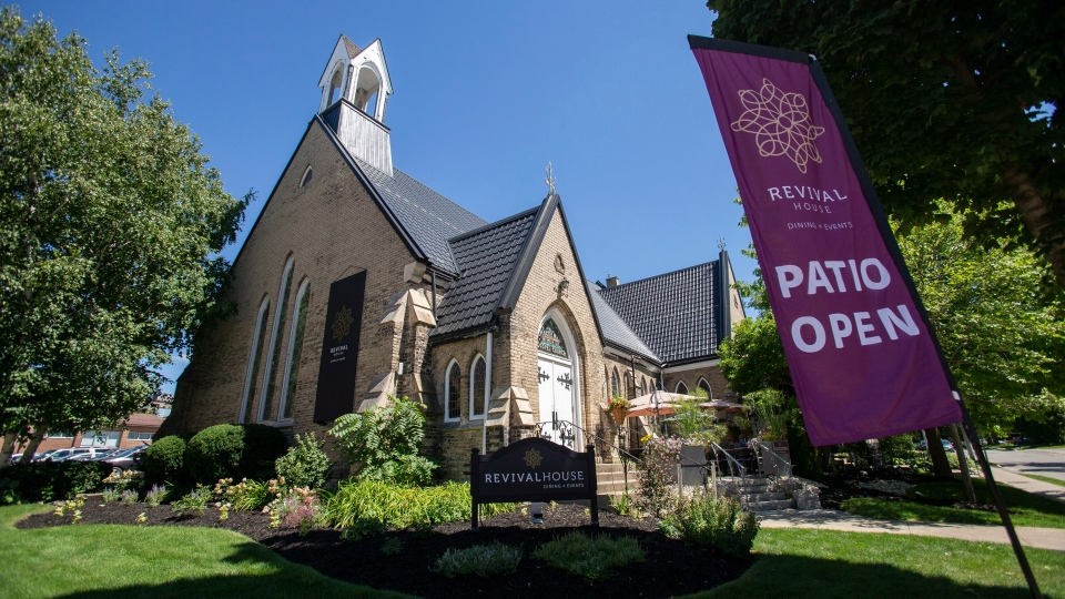 A sign flutters in the wind outside at the Revival House restaurant in Stratford, Ont., on Friday, August 10, 2018. THE CANADIAN PRESS/Geoff Robins