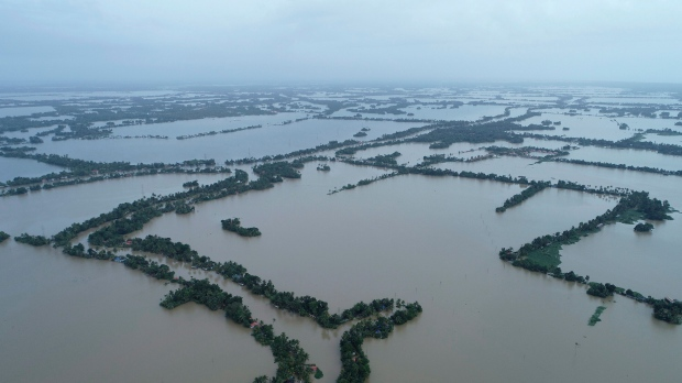 An aerial view of flooded Kuttanad in Alappuzha district, in the southern state of Kerala, India, Sunday, Aug.19, 2018. Over 300 people have died and 300,000 are displaced in the worst flooding in a century. (AP Photo/ Charly K C)