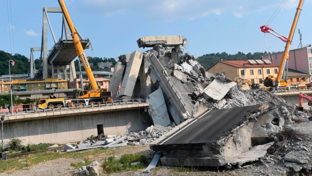 A view of the collapsed Morandi highway bridge, in Genoa, Italy, Sunday, Aug. 19, 2018. The unofficial death toll in Tuesday's collapse rose to 43 Saturday. (Luca Zennaro/ANSA via AP)