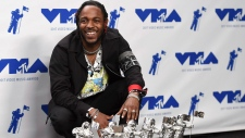 "Kendrick Lamar poses in the press room with the awards for best hip hop video, best direction, best cinematography, best art direction, best visual effects, and video of the year for ""HUMBLE."" at the MTV Video Music Awards at The Forum on Sunday, Aug. 27, 2017, in Inglewood, Calif. (Photo by Jordan Strauss/Invision/AP)"