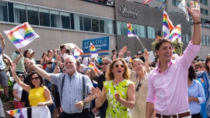 Prime minister Justin Trudeau, his wife Sophie Gregoire Trudeau, Quebec Premier Philippe Couillard and Montreal mayor Valerie Plante march in the pride parade in Montreal on Sunday, August 19, 2018. THE CANADIAN PRESS/Paul Chiasson