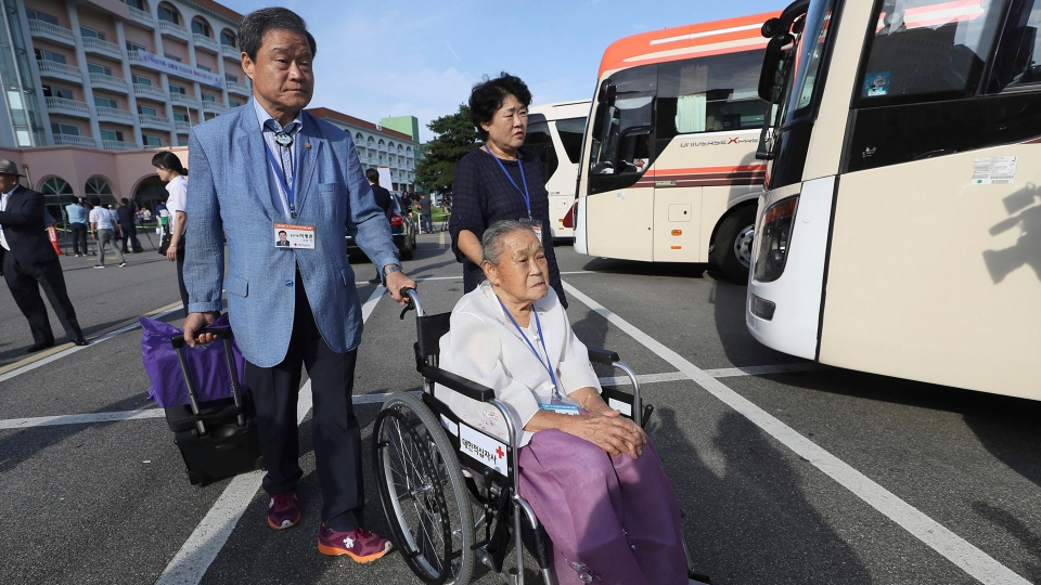 South Koreans leave for North Korea to take part in family reunions with their North Korean family members at a hotel in Sokcho, South Korea, Monday, Aug. 20, 2018. (Lee Ji-eun/Yonhap via AP)