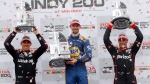 Robert Wickens, left, hoists the second place trophy while Alexander Rossi, center, holds the first place trophy and Will Power hoists the third place trophy in victory lane after winning the IndyCar Series auto race, Sunday, July 29, 2018, at Mid-Ohio Sports Car Course in Lexington, Ohio. (AP Photo/Tom E. Puskar)