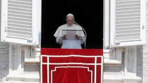 """In this Sunday, Aug. 19, 2018 file photo, Pope Francis prays for the victims of the Kerala floods during the Angelus noon prayer in St.Peter's Square, at the Vatican. Pope Francis has issued a letter to Catholics around the world condemning the """"crime"""" of priestly sexual abuse and cover-up and demanding accountability, in response to new revelations in the United States of decades of misconduct by the Catholic Church. (AP Photo/Gregorio Borgia, File)"""