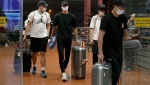 "Four Japanese basketball players arrive at Jakarta airport Monday, Aug. 20, 2018. They were kicked off their Asian Games team and sent home Monday after delegation head Yasuhiro Yamashita said they ""spent the night in a hotel with women."" (Jun Hirata / The Associated Press)"