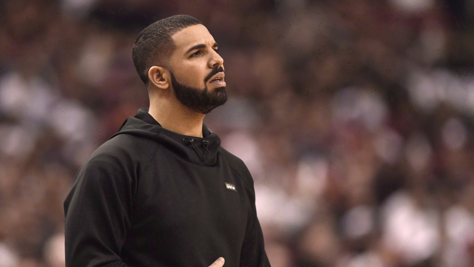 Rapper Drake watches the action between the Indiana Pacers and the Toronto Raptors during first half NBA playoff basketball action in Toronto on Tuesday, April 26, 2016. Drake's first Canadian stop on his Aubrey & The Three Migos Tour has been cancelled. THE CANADIAN PRESS/Frank Gunn