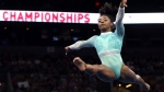 Simone Biles competes on the floor exercise at the U.S. Gymnastics Championships, Sunday, Aug. 19, 2018, in Boston. (AP Photo/Elise Amendola)
