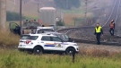 CP Rail staff and RCMP members near the intersection of Highway 1A and Highway 22 in Cochrane following the discovery of a body near the train tracks on August 20, 2018