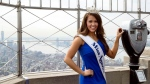In this Sept. 12, 2017, file photo, newly-crowned Miss America 2018 Cara Mund poses for photographers on the 86th Floor Observation Deck of the Empire State Building, in New York. (AP Photo/Mary Altaffer, File)