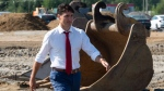 Prime Minister Justin Trudeau walks through a construction area before participating in a ground breaking ceremony for an Amazon distribution centre in Ottawa, Monday August 20, 2018. THE CANADIAN PRESS/Adrian Wyld