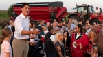 Prime Minister Justin Trudeau addresses local Liberals and Liberal MPs from the South Shore of Montreal for a summer corn roast in Sabrevois, Que., on Thursday, Aug. 16, 2018. (Paul Chiasson / THE CANADIAN PRESS)