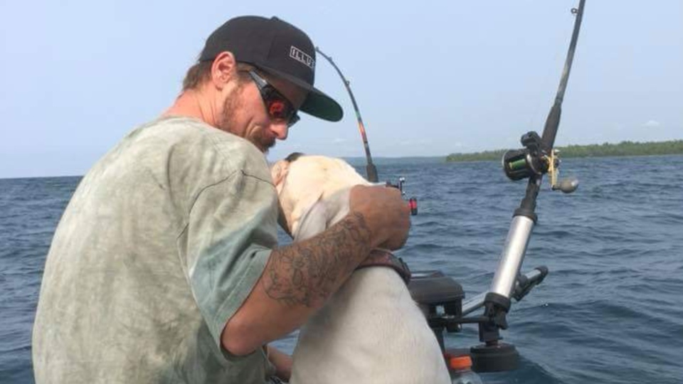 Derick Henry, 27, of Cambridge, Ont. seen here fishing with a family pet was a 'good swimmer', says family. (photo: August 18, 2018/Facebook)