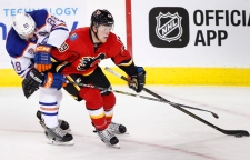 NHL profile photo on Calgary Flames' Hunter Shinkaruk, right, playing against Edmonton Oilers' Brandon Davidson at an NHL game in Calgary, Alberta on Sept. 26, 2016. THE CANADIAN PRESS IMAGES/Larry MacDougal