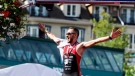 Cody Beals after crossing the finish line for the Mont-Tremblant IRONMAN. (@koruptvision / Twitter)