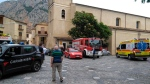 Rescue vehicles gather in Civita, Italy, Monday, Aug. 20, 2018. Italy's civil protection agency says at least eight people were killed when a rain-swollen river flooded a gorge in the southern region of Calabria. (Clemente Angotti/ANSA via AP)