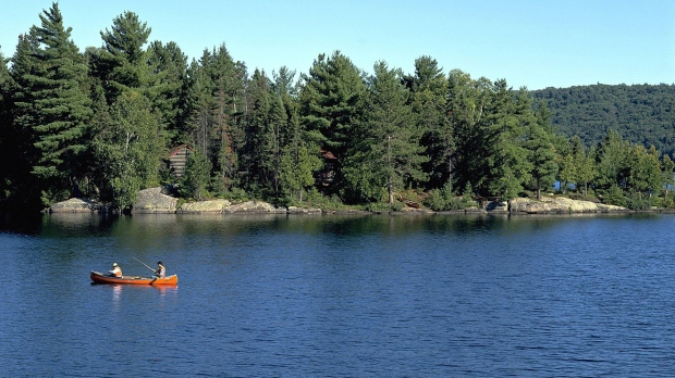 People canoe in Algonquin Provincial Park in Ontario, Canada, in this 2001 photo. (Algonquin Park / Ontario Tourism via The Canadian Press)