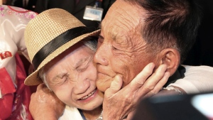 South Korean Lee Keum-seom, 92, left, weeps with her North Korean son Ri Sang Chol, 71, during the Separated Family Reunion Meeting at the Diamond Mountain resort in North Korea, Monday, Aug. 20, 2018. (Lee Ji-eun/Yonhap via AP)