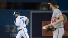 Toronto Blue Jays designated hitter Kendrys Morales (8) round the bases past Baltimore Orioles starting pitcher Andrew Cashner (54) after hitting a three run home run during fifth inning AL baseball action in Toronto on Monday, August 20, 2018. THE CANADIAN PRESS/Nathan Denette