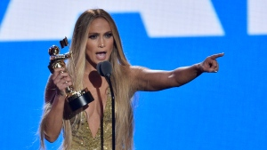 Jennifer Lopez accepts the Video Vanguard award at the MTV Video Music Awards at Radio City Music Hall on Monday, Aug. 20, 2018, in New York. (Photo by Chris Pizzello/Invision/AP)