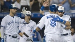 Toronto Blue Jays designated hitter Kendrys Morales (8) celebrates with centre fielder Kevin Pillar, right, and teammates after hitting a three run home run against the Baltimore Orioles during fifth inning AL baseball action in Toronto on Monday, Aug. 20, 2018. THE CANADIAN PRESS/Nathan Denette