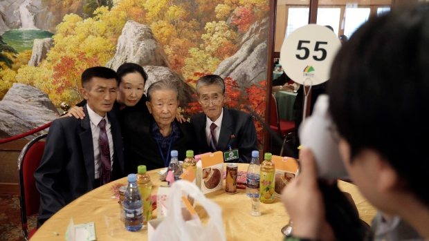 Lee Moon-hyuk, 95, third from left, takes pictures with his North Korean relatives during a separated family reunion meeting at the Diamond Mountain resort in North Korea, Tuesday, Aug. 21, 2018. (Korea Pool Photo via AP)