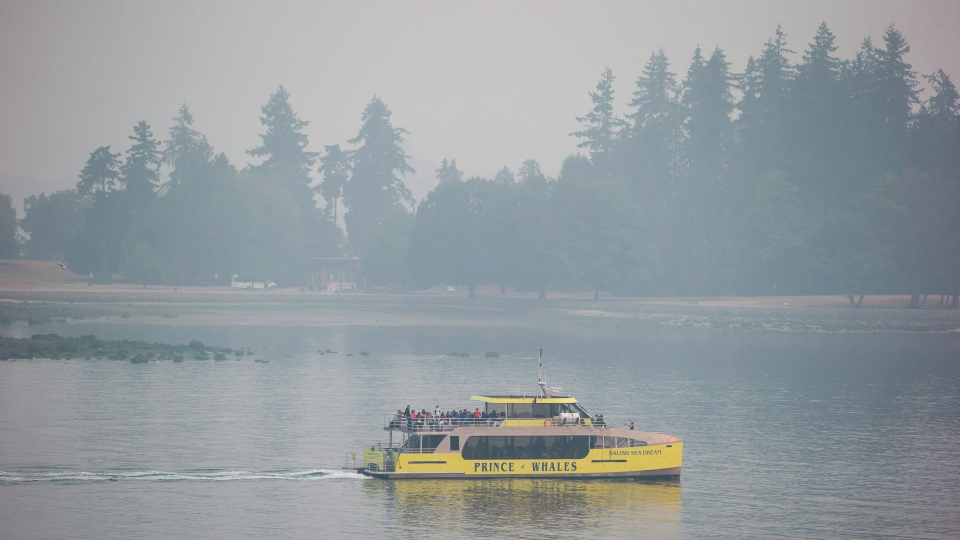 A whale watching boat carrying people leaves the harbour as smoke from wildfires burning in the province fills the air in Vancouver on Monday August 20, 2018. (THE CANADIAN PRESS / Darryl Dyck)