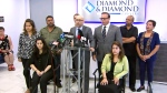 Some of the six people suing the Bombay Bhel restaurant after they were injured in a May 24 bombing appear at a news conference with their lawyers on August 21, 2018.
